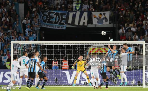 Real Madrid attack as Gremio players defend near the goal during the Club World Cup UAE 2017 final football match between Gremio FBPA and Real Madrid...