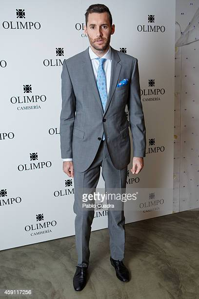 Real Madrid basketball player Rudy Fernandez poses during a photocall to present the new 2015 Olimpo collection at Otto restaurant on November 17...