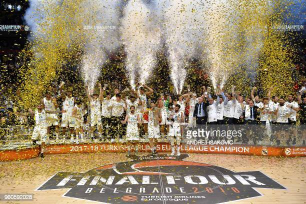 Real Madrid basketball players celebrate with the trophy their team's 8580 win in the Euroleague Final Four finals basketball match between Real...