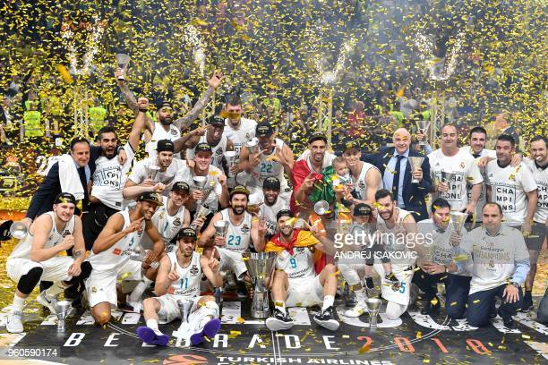Real Madrid basketball players pose with the trophy as they celebrate their team's 8580 win in the Euroleague Final Four finals basketball match...