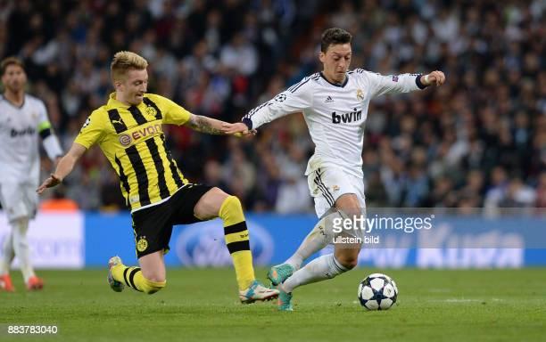 FUSSBALL CHAMPIONS Real Madrid Borussia Dortmund Marco Reus graetscht Mesut Oezil ab