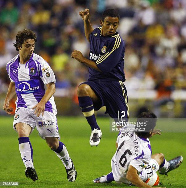 Real Madrid Brazilian's Marcelo vies with Valladolid's Pedro Lpez and Borja Fernndez during their Liga football match at the Jose Zorrilla stadium in...