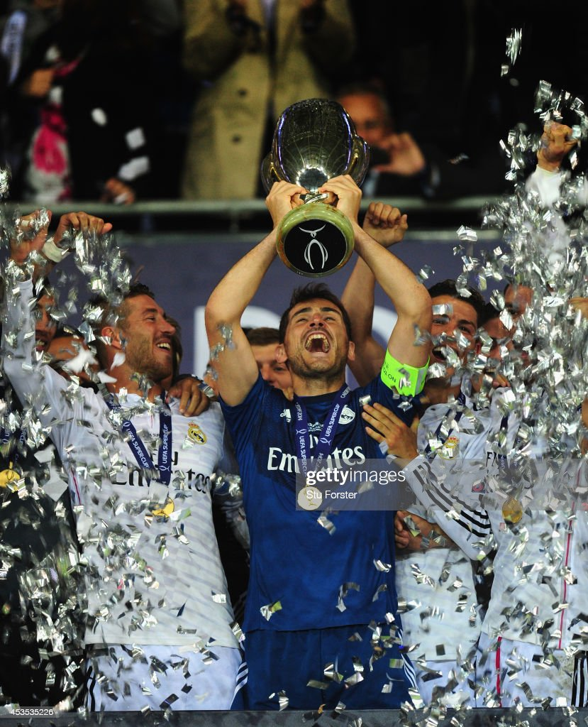 Real Madrid captain Iker Casillas lifts the trophy after the UEFA Super Cup match between Real Madrid and Sevilla FC at Cardiff City Stadium on August 12, 2014 in Cardiff, Wales.