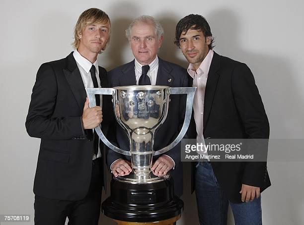 Real Madrid Captain Raul Gonzalez , president Ramon Calderon and Guti pose with the Liga trophy at the Santiago Bernabeu stadium on June 18, 2007 in...