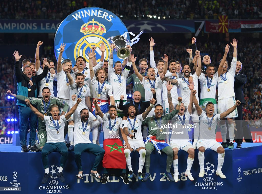 Real Madrid captain Sergio Ramos lifts the trophy after winning the UEFA Champions League final between Real Madrid and Liverpool on May 26, 2018 in Kiev, Ukraine.