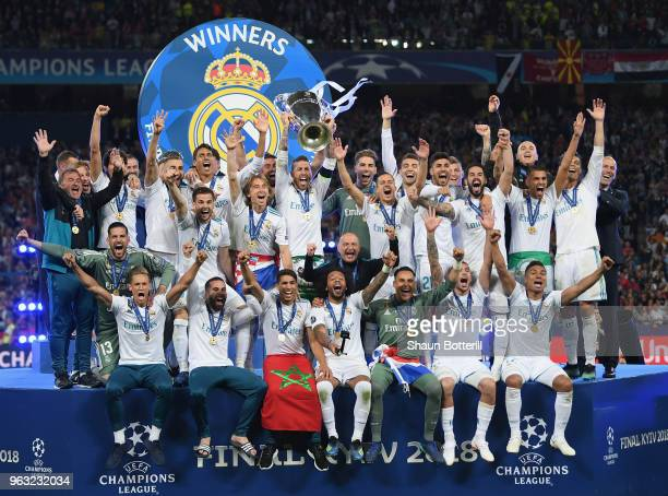 Real Madrid captain Sergio Ramos lifts the trophy after winning the UEFA Champions League final between Real Madrid and Liverpool on May 26 2018 in...