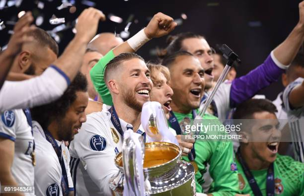 Real Madrid captain Sergio Ramos Real Madrid's Croatian midfielder Luka Modric and Real Madrid's Costa Rican goalkeeper Keylor Navas celebrate with...