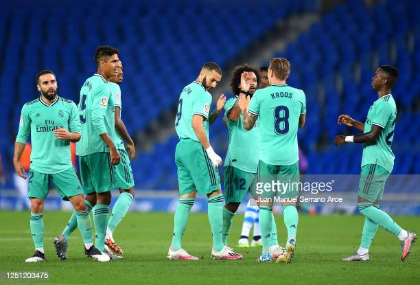 Real Madrid celebrate the second goal scored by Karim Benzema during the Liga match between Real Sociedad and Real Madrid CF at Estadio Anoeta on...