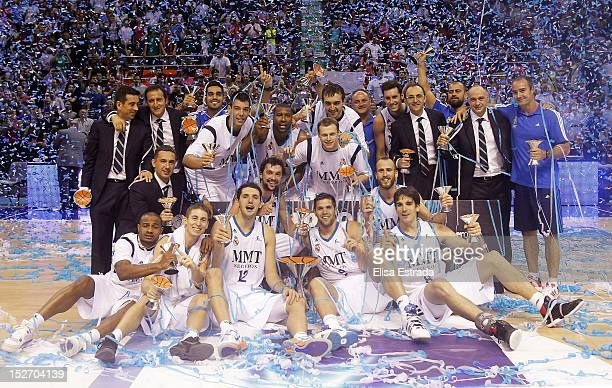Real Madrid celebrate with the trophy after winning the Supercopa ACB Final match between Real Madrid and Barcelona Regal at Principe Felipe pavilion...