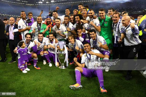 Real Madrid celebrate with the trophy following the UEFA Champions League Final match between Juventus and Real Madrid at the National Stadium of...
