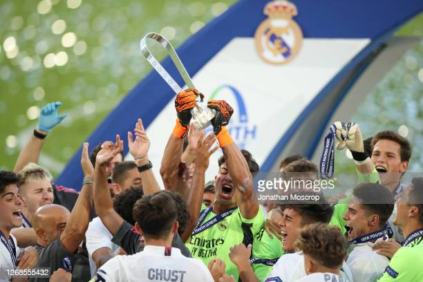 Real Madrid celebrate with the trophy following the UEFA Youth League Final 2019/20 between SL Benfica and Real Madrid CF at August 25, 2020 in Nyon,...