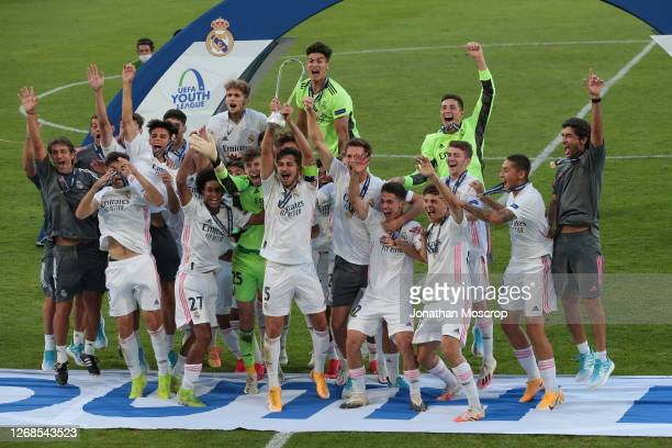 Real Madrid celebrate with the winners' trophy following their 3-2 victory in the UEFA Youth League Final against Benfica at Colovray Sports Centre...