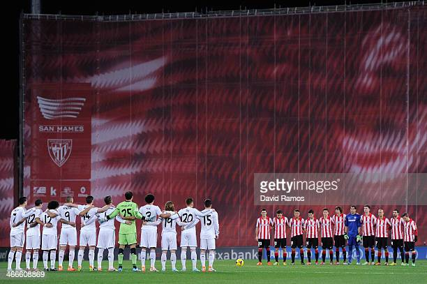 Real Madrid CF and Athletic Club de Bilbao players observe a minute silence in memory of former Spain National Team coach Luis Aragones during the La...