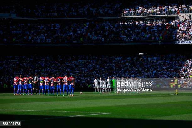 Real Madrid CF and Atletico de Madrid players observe one minute of silence in honor the victims of the Stockholm terrorist attack prior to start the...