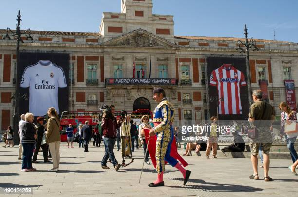 Real Madrid CF and Club Atletico de Madrid shirt banners hang from the regional Madrid government building at Puerta del Sol square on May 14 2014 in...