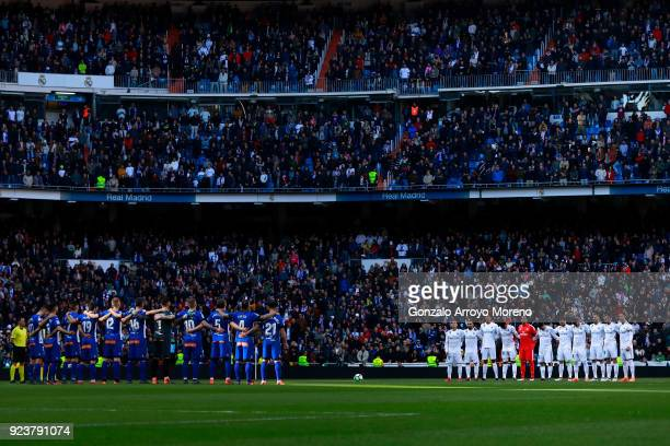 Real Madrid CF and Deportivo Alaves players observe one minute of silence in memorial of the riot police officer deceased during the riots between...