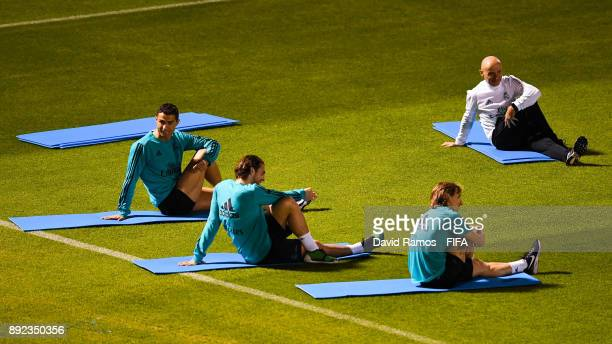 Real Madrid CF Cristiano Ronaldo Mateo Kovacic and Luka Modric stretch during a training session at the New York University stadium on December 14...
