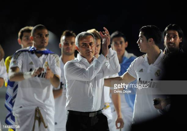 Real Madrid CF head coach Jose Mourinho celebrates the La Liga title with Cristiano Ronaldo after the La Liga match between Real Madrid CF and RCD...