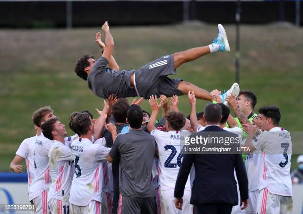 Real Madrid CF head coach Raúl González Blanco is held aloft in celebration following the UEFA Youth League Final 2019/20 between SL Benfica and Real...