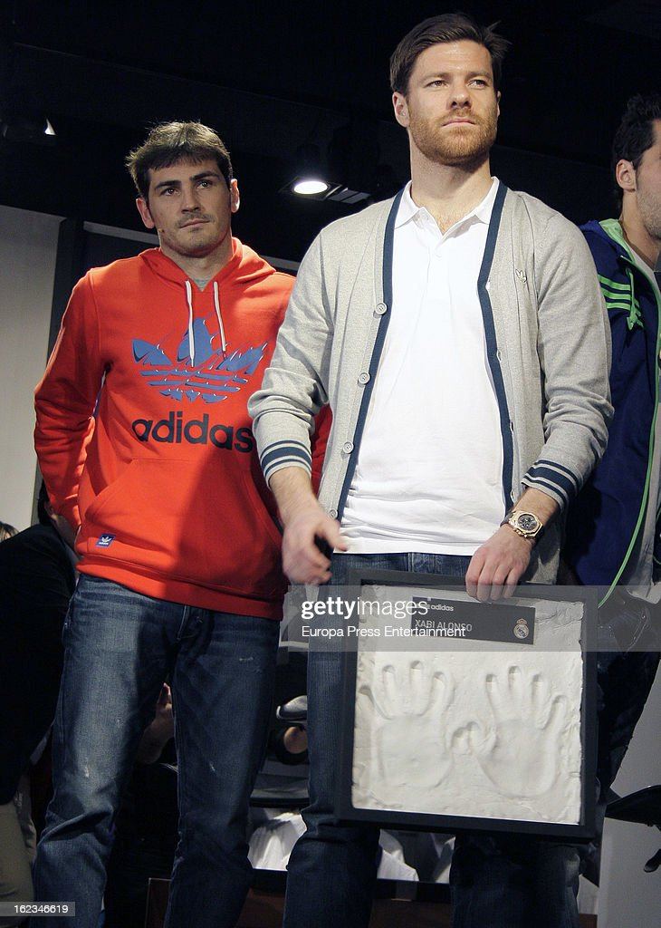 Real Madrid CF player Xabi Alonso (R) and Iker Casillas attend the opening of the new 'Adidas' store at the Santiago Bernabeu stadium on February 21, 2013 in Madrid, Spain.