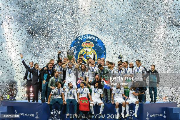 Real Madrid CF players ceebrates with the trophy following his side victory in the UEFA Champions League final between Real Madrid and Liverpool on...