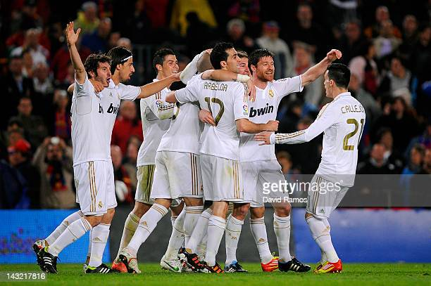 Real Madrid CF players celebrate after defeating FC Barcelona at the end of the La Liga match between FC Barcelona and Real Madrid at Camp Nou on...