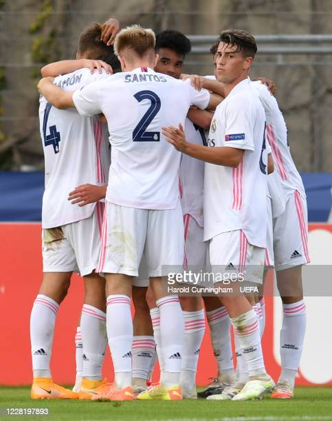Real Madrid CF players celebrate after Henrique Jocu of SL Benfica scored an own goal during the UEFA Youth League Final 2019/20 between SL Benfica...