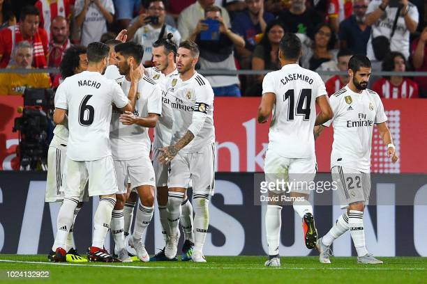 Real Madrid CF players celebrate after Karim Benzema of Real Madrid CF scored his team's second goal from the penalty spot during the La Liga match...