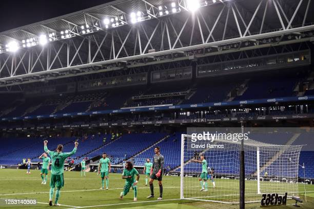 Real Madrid CF players celebrate at the end of the Liga match between RCD Espanyol and Real Madrid CF at RCDE Stadium on June 28 2020 in Barcelona...