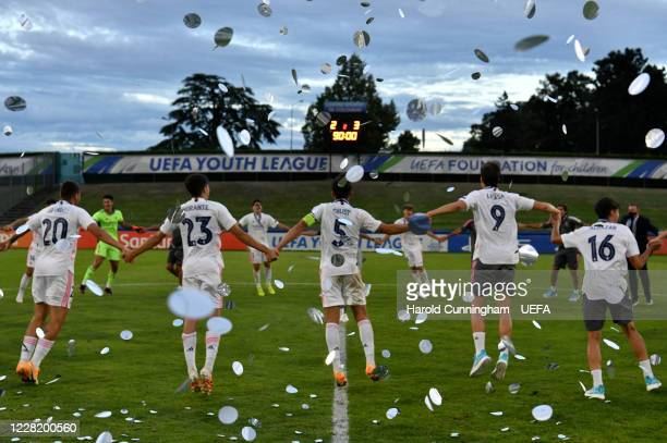 Real Madrid CF players celebrate following the UEFA Youth League Final 2019/20 between SL Benfica and Real Madrid CF at Colovray Sports Center on...