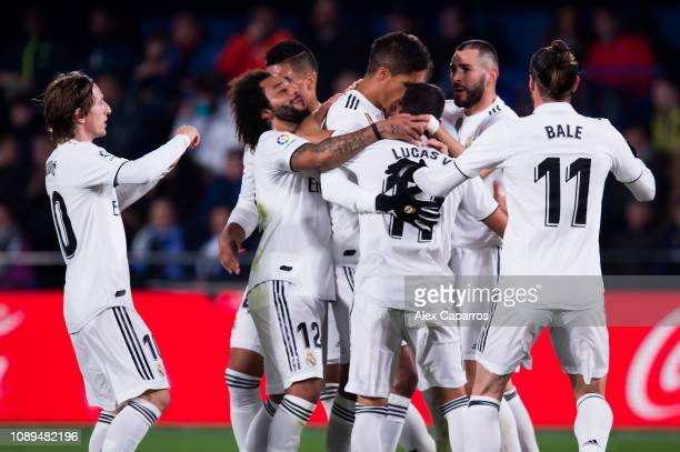 Real Madrid CF players celebrate with Raphael Varane after scoring his team's second goal during the La Liga match between Villarreal CF and Real...