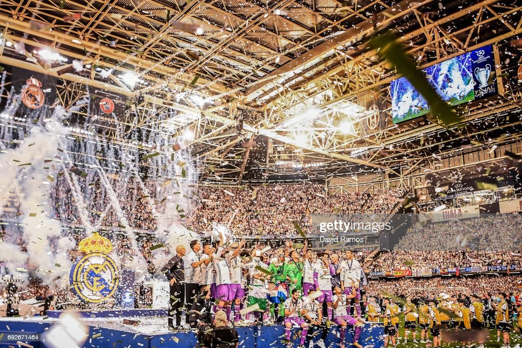 Real Madrid CF players celebrate with the trophy after the UEFA Champions League Final between Juventus and Real Madrid at National Stadium of Wales on June 3, 2017 in Cardiff, Wales.