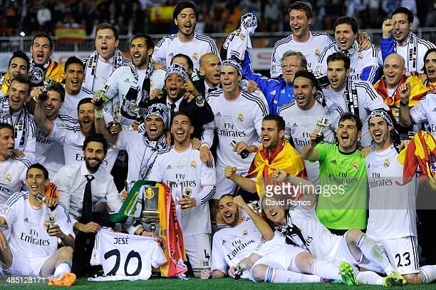 Real Madrid CF players celebrate with the trophy after winning the Copa del Rey Final between Real Madrid and FC Barcelona at Estadio Mestalla on...
