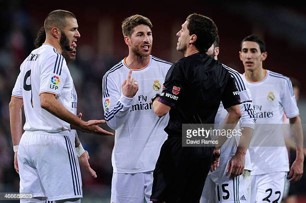 Real Madrid CF players Karim Benzema and Sergio Ramos argue with the referee Ayza Gamez after Cristiano Ronaldo of Real Madrid CF was shown a red...