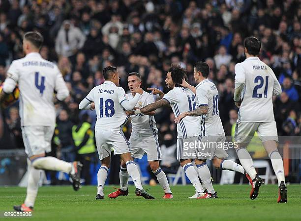 Real Madrid CF players Mariano Diaz Mejia and Marcelo celebrate after scoring their 2nd goal during the La Liga match between Real Madrid CF and RC...