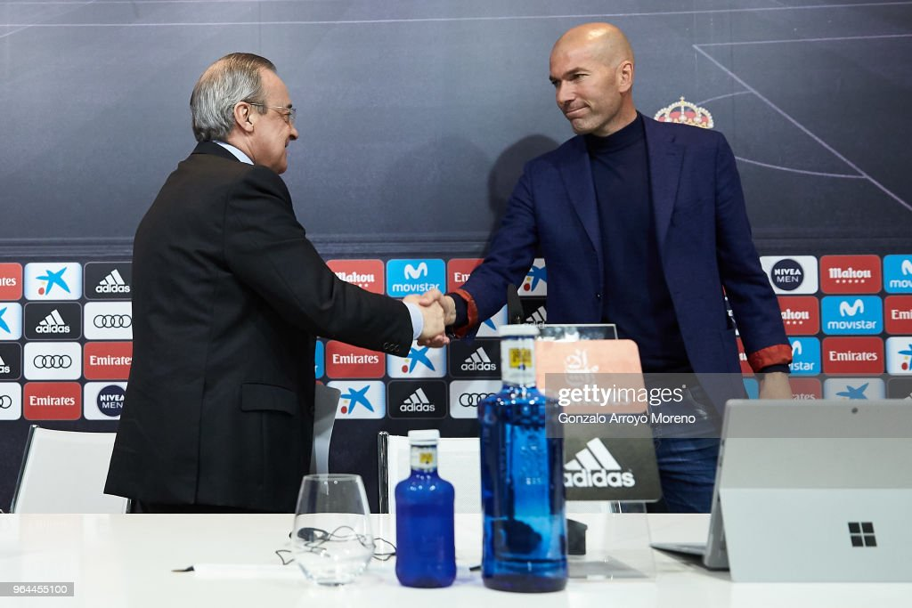 Real Madrid CF president Florentino Perez (L) and Zinedine Zidane (R) shake hands after a press conference to announce his resignation as Real Madrid manager at Valdebebas Sport City on May 31, 2018 in Madrid, Spain. Zidane steps down from the position of Manager of Real Madrid, after leading the club to it's third consecutive UEFA Champions League title.