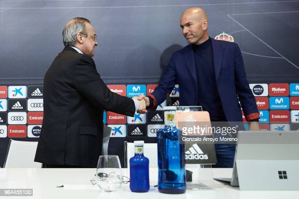 Real Madrid CF president Florentino Perez and Zinedine Zidane shake hands after a press conference to announce his resignation as Real Madrid manager...