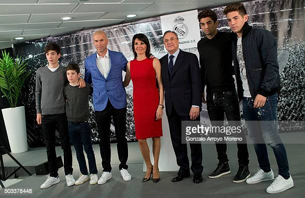 Real Madrid CF president Florentino Perez poses for a picture with Zinedine Zidane as new Real Madrid head coach sourrounded by his family wife...