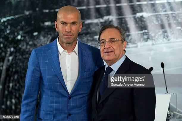Real Madrid CF president Florentino Perez poses with Zinedine Zidane as he is announced as the new Real Madrid head coach at Santiago Bernabeu...