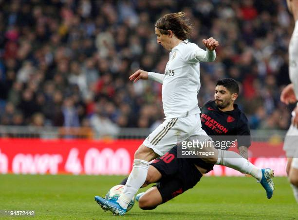 Real Madrid CF's Luka Modric and Sevilla FC's Ever Banega are seen in action during the Spanish La Liga match round 20 between Real Madrid and...