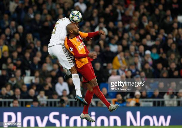 Real Madrid CF's Rapahel Varane and Galatasaray's Marcao competes for the ball during the UEFA Champions League match between Real Madrid and...
