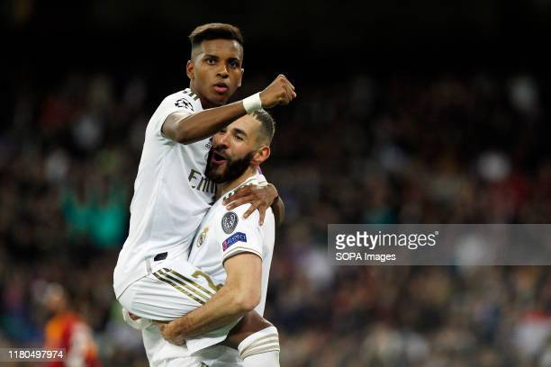 Real Madrid CF's Rodrygo Goes and Real Madrid CF's Karim Benzema celebrates after scoring a goal during the UEFA Champions League match between Real...