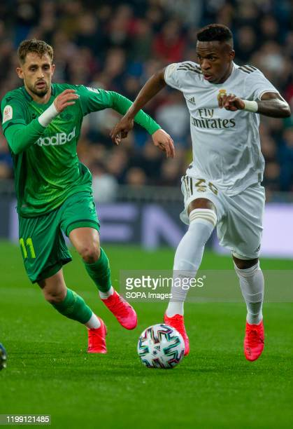 Real Madrid CF's Vinicius Jr and Real Sociedad's Adnan Januzaj are seen in action during the Spanish quarterfinal Copa del Rey match between Real...