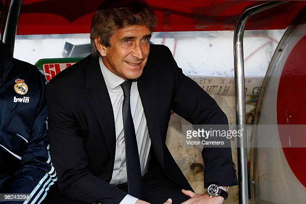 Real Madrid coach Manuel Pellegrini looks on before the La Liga match between Racing Santander and Real Madrid at El Sardinero on April 4 2010 in...