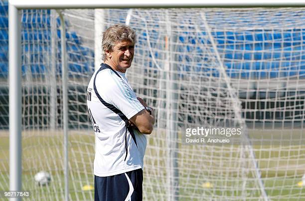 Real Madrid coach Manuel Pellegrini looks on during a training sessiona at Valdebebas on April 28 2010 in Madrid Spain