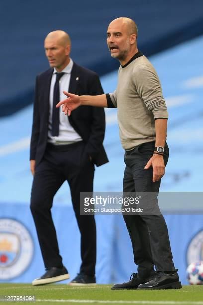 Real Madrid coach Zinedine Zidane and Man City manager Pep Guardiola during the UEFA Champions League round of 16 second leg match between Manchester...