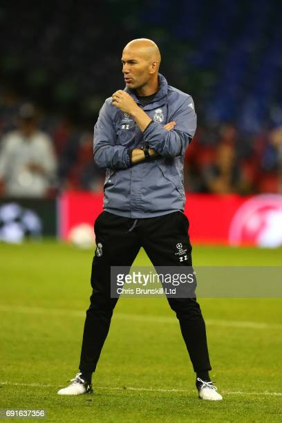 Real Madrid coach Zinedine Zidane looks on during a Real Madrid training session ahead of the UEFA Champions League Final at the National Stadium of...