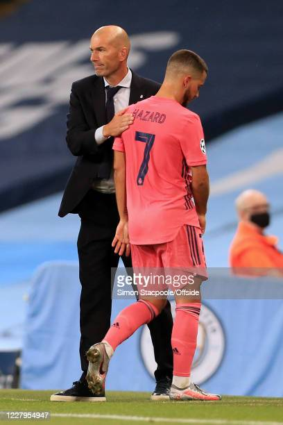 Real Madrid coach Zinedine Zidane pats Eden Hazard on the back after subbing him off during the UEFA Champions League round of 16 second leg match...