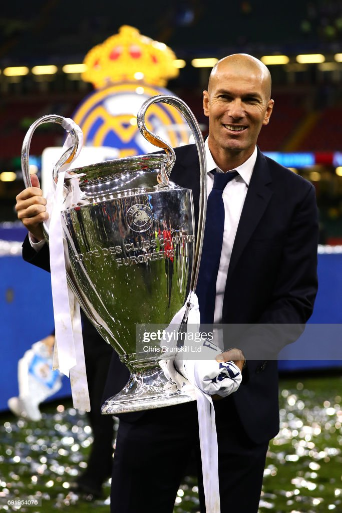Real Madrid coach Zinedine Zidane poses with the trophy following the UEFA Champions League Final match between Juventus and Real Madrid at the National Stadium of Wales on June 3, 2017 in Cardiff, Wales.
