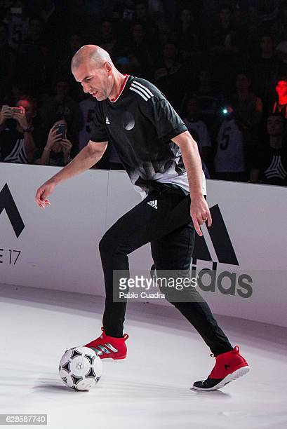 Real Madrid coach Zinedine Zidane presents the new ACE17 Red Limit Boots by Adidas on December 8 2016 in Madrid Spain